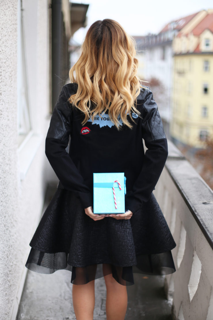 blue present, black leatherjacket, dress